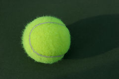 Tennis Ball on Court. Tennis ball Royalty Free Stock Image