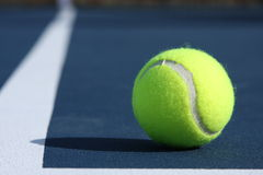Tennis Ball on Court. Tennis ball on a blue court Royalty Free Stock Images