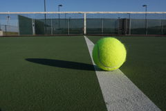 Tennis Ball on the Court Stock Photography