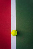 Tennis ball. On the tennis court Royalty Free Stock Photography