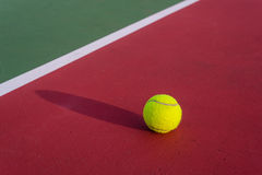 Tennis ball. On the tennis court Royalty Free Stock Image