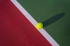 Tennis ball. On the tennis court Royalty Free Stock Photo
