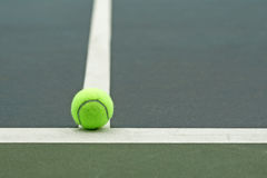 Tennis ball  on court. Background Royalty Free Stock Images