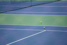 Tennis ball on the court Royalty Free Stock Photography