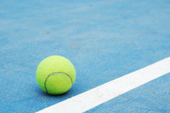Tennis ball. On court at base line Stock Image