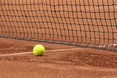 Tennis ball on court Royalty Free Stock Photo