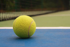 Tennis Ball on the Court Royalty Free Stock Photos