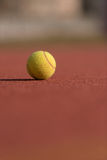 Tennis Ball on the Court Close up Royalty Free Stock Image