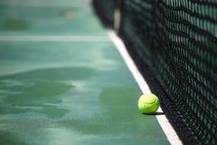 Tennis ball on court Royalty Free Stock Photo