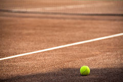 Tennis ball and court Stock Photo