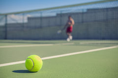 Tennis ball on court with copy space Royalty Free Stock Images