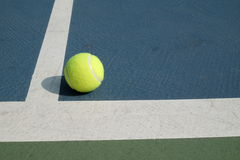 Tennis ball in court Stock Image