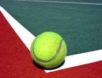 Tennis Ball on Court with Corner White Line  Royalty Free Stock Images