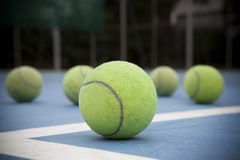 Tennis ball on court field Stock Images