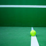 Tennis ball on court Stock Images