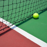 Tennis ball on court Royalty Free Stock Photography