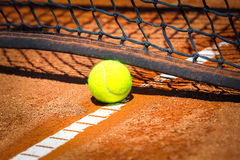 Tennis ball on court. Green Tennis ball on court Royalty Free Stock Image