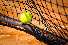 Tennis ball on court. Green Tennis ball on court Royalty Free Stock Photos