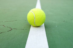 Tennis Ball on the Court. Tennis Ball on the green Court stock photos