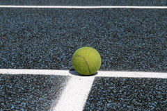 Tennis ball on court line Royalty Free Stock Images
