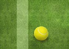 Tennis ball beside the court line.  Royalty Free Stock Image