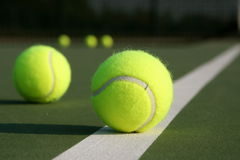Tennis ball on the court line Royalty Free Stock Image