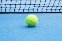 Tennis ball. On court with net Royalty Free Stock Images