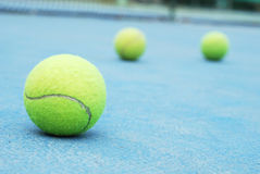 Tennis ball. On court with net Stock Photos