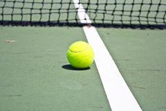 Tennis Ball on the Court Royalty Free Stock Photo