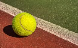 Tennis ball on the court, out of the line
