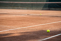 Tennis ball and court Royalty Free Stock Image