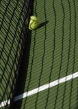 Tennis Ball on Court in Shadow royalty free stock photo