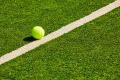 Tennis Ball on the Court. The tennis Ball on the Court. Summer day Stock Images