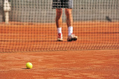 Tennis ball on court and tennis player Stock Photos