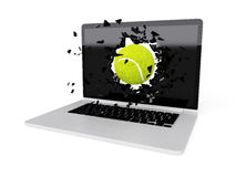 Tennis ball destroy laptop Stock Photography