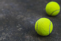 Tennis ball on the dirty ground Royalty Free Stock Image