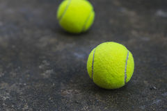 Tennis ball on the dirty ground Stock Photos