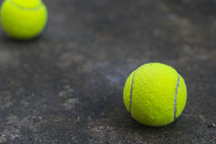Tennis ball on the dirty ground Royalty Free Stock Images