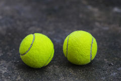 Tennis ball on the dirty ground Stock Photography