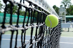 Tennis ball don't pass net. Feeling not success in something Stock Image