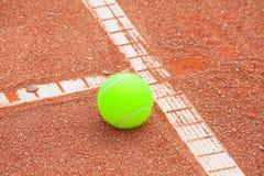 Tennis ball. On the field stock photo