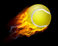 Tennis Ball on Fire. A flaming tennis ball on fire flying through the air Royalty Free Stock Image