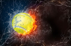 Tennis ball in fire and water. Tennis ball on fire and water with lightening around on black background. Horizontal layout with text space Stock Photo
