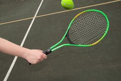 Tennis ball in flight Stock Photo
