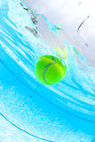 Tennis ball floating in swimming pool Stock Image