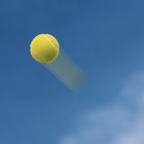 Tennis ball. Flying into the sky Stock Image