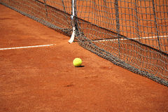 Tennis ball in front of the net Royalty Free Stock Photo