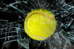 Tennis ball through glass. Royalty Free Stock Image