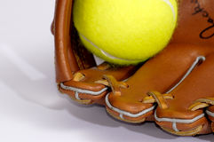 Tennis ball and glove stock images