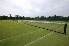 Tennis ball on grass tennis court. Tennis ball on grass  tennis court royalty free stock photography